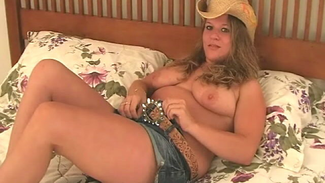 Hottie Blonde Cowgirl Christy Stripping And Displaying Her Massive Tits In Bed Room