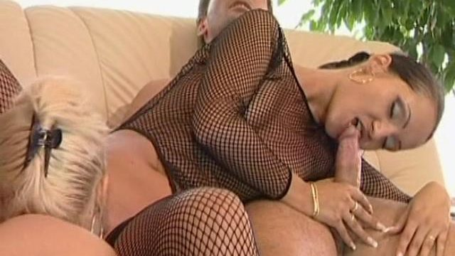 Two Provoking Younger Lesbians In Fishnets Sharing A Large Clarinet